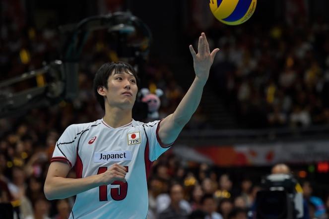 MasahiroYanagidaofJapanservestheball